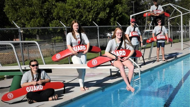 Lifeguards at the Weed Pool are ready for swimmers since the pool opened for the season on Monday.