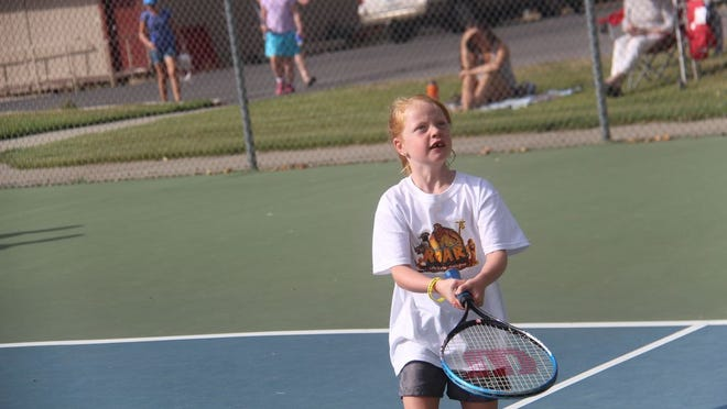 A participant in last year's Siskiyou Family YMCA Tennis Camp.             photo by Bill Choy