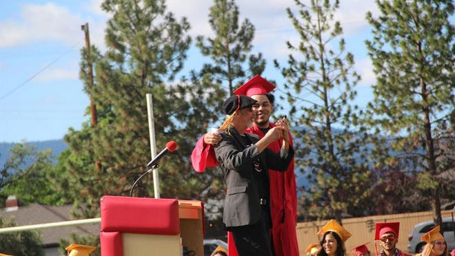 Beloved teacher Kevin Velarde was the speaker at Yreka High School's commencement ceremony June 6. He was introduced by YHS class president Kobe Green. After nearly 30 years teaching in Yreka at YHS and Discovery High School, Velarde is retiring.