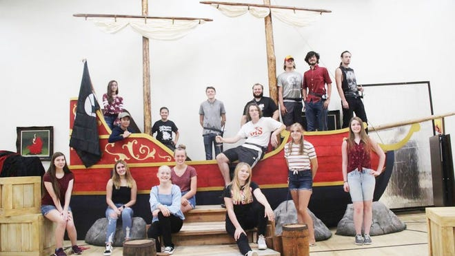 "Much of the cast of Yreka High School's ""Pirates of Penzance"" gather on one of the sets last week. They'll perform the play outdoors at Hibbard Field, with opening night on Friday."
