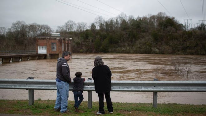 Culleoka residents Don Baum, Patty Baum  and their grandson Joseph Baum, 5, watch the flooded banks of the Duck River at Riverwalk Park in Columbia on Thursday, Feb., 6, 2020.
