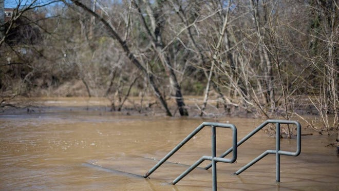 The rising banks of the Duck River submerge a staircase at Riverwalk Park in Columbia on Friday, Feb. 14, 2020.