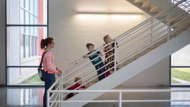 Melaina Perry explores the Northfield Workforce Development Center with her children Judah Perry, 1, Nathanael Perry, 2, and Whitley Perry on Tuesday, March 3, 2020.