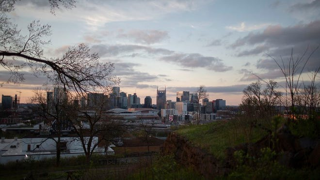 The sun sets over the Nashville skyline on Saturday, March 21, 2020.