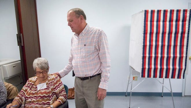 Election Official Shirley Kelley, left, and Maury County Maury CountyAdministrator ofElections Todd Baxter, right,  at the Maury County Election Commission on the the first day of early voting for the Nov. 6 general election on Wednesday, Oct. 17, 2018.