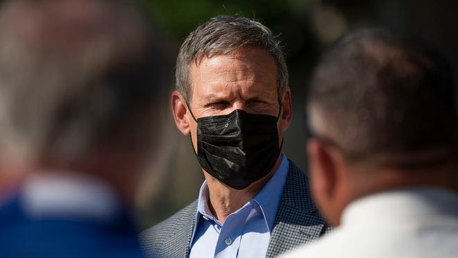 Tennessee Gov. Bill Lee wears a mask as he attends a kickoff event for the construction of a new visitor center and restaurant at Henry Horton State Park in Chapel Hill, Tenn., on Wednesday, July 15, 2020.