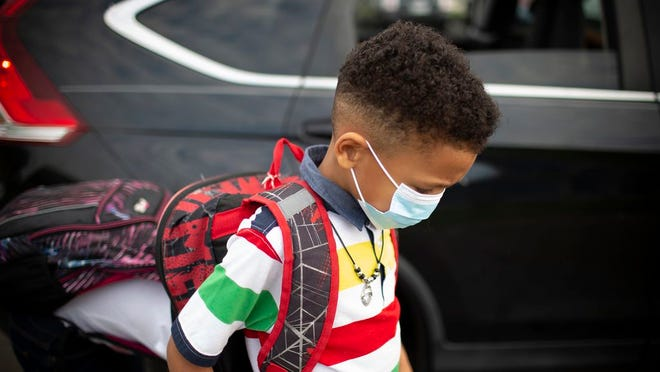 Santino Morris arrives at Joseph Brown Elementary School in Columbia, Tenn., on Monday, Aug. 10, 2020. The day marked the first time students returned to school after the presence of the coronavirus caused schools to shut down in March 2020.