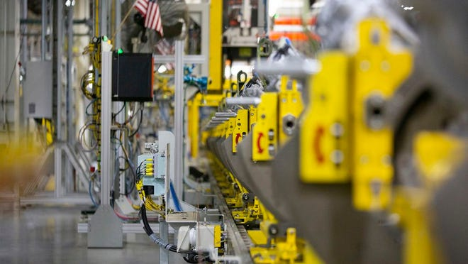 Engine blocks sit on the Global Propulsion Systems assembly line at the General Motors manufacturing facility in Spring Hill on Thursday, Jan. 16, 2020.