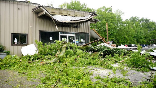 Branches cover the area in front of the Spring Hill Veterinary Clinic in Spring Hill, Tenn., Monday, May 4, 2020, after rain and high winds hit Sunday.
