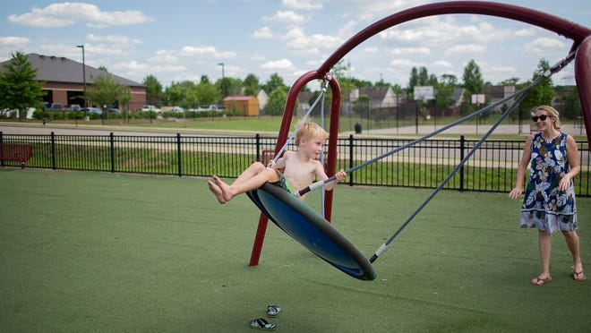 Xander Hudson, 6, is pushed y his mother Jill Hudson on a swing at Port Royal Park in Spring Hill, Tenn., on the first day of the park reopening following an extended closure to prevent the spread of the coronavirus on Saturday, June 13, 2020.