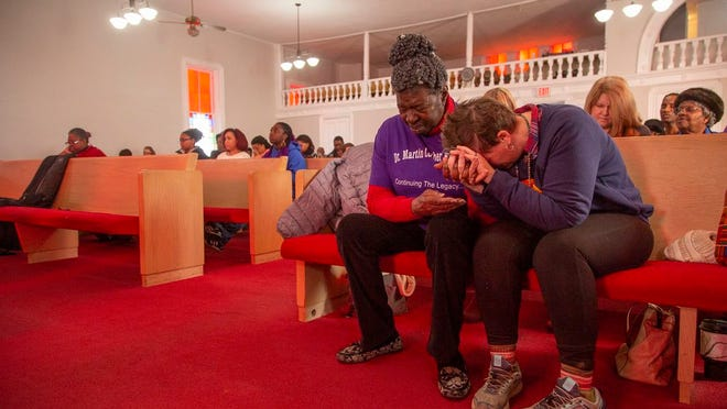 Annie Hardison, a member of the Maury County County Concerned Citizens, and Kimberly Ladd hold hands in prayer during the Propelled with a Purpose celebration in honor of Martin Luther King, Jr., at Mt. Lebanon Missionary Baptist Church in Columbia on Monday Jan. 21, 2019.