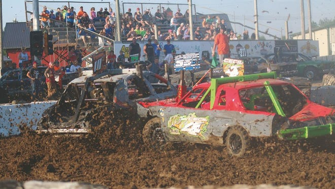 Mud flies during the demo derby at the 2019 Dallas County Fair. All grandstand events have been canceled for the 2020 Dallas County Fair.