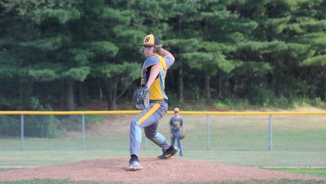 Keaton Eberly tosses a pitch for the Garfield Dukes Sunday.