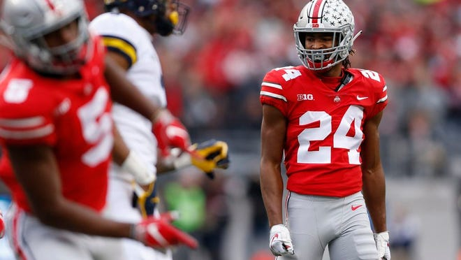 Ohio State cornerback Shaun Wade (24), shown here in the 2018 Michigan game, is among the players whose parents are fighting for them to play football this season. Wade's father, Randy, will travel to Chicago on Friday with hopes of meeting with Big Ten commissioner Kevin Warren.