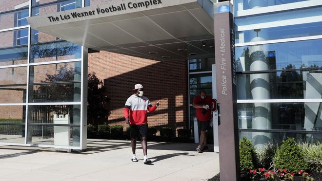 An Ohio State Buckeyes football staff member leaves voluntary workouts on Monday, June 8, 2020 at the Woody Hayes Athletic Center in Columbus, Ohio. Voluntary workouts were temporarily suspended on July 9, 2020.