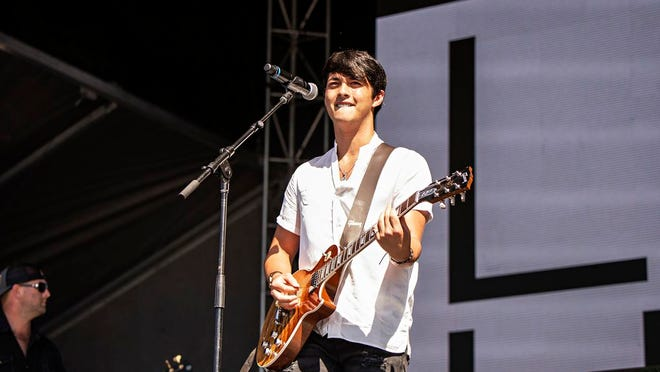 """FILE - In a  Saturday, Sept. 14, 2019 file photo, Laine Hardy performs during KAABOO 2019 at the Del Mar Racetrack and Fairgrounds, in San Diego, Calif. The 2019 """"American Idol"""" winner Laine Hardy says he's been diagnosed with COVID-19. The 19-year-old singer from Livingston, Louisiana, made the announcement Sunday, June 21, 2020 on social media. Hardy says his symptoms are mild and he's recovering under home quarantine."""