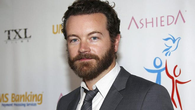 "FILE - In this March 24, 2014 file photo, actor Danny Masterson arrives at Youth for Human Rights International Celebrity Benefit at Beso Hollywood in Los Angeles. Masterson, known for his roles in ""That '70s Show"" and ""The Ranch,"" has been charged with raping three women, Los Angeles County District Attorney's officials announced Wednesday, June 17, 2020. The incidents occurred between 2001 and 2003, officials allege. The 44-year-old actor faces three counts of rape by force or fear."
