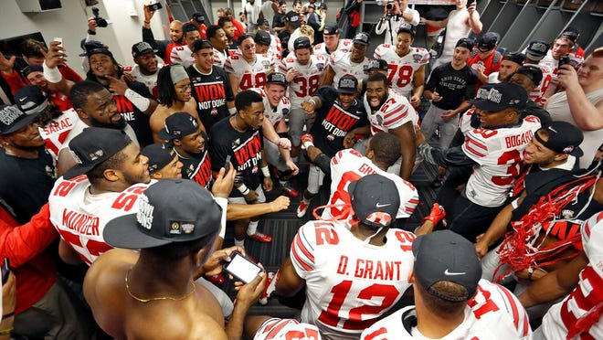 Ohio State players pack in while celebrating a win over Alabama in a College Football Playoff game on Jan. 1, 2015. In cramped spaces, virus-containing particles more easily travel among people and can circulate longer in the air.
