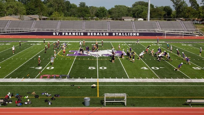 DeSales football players practice at the school Aug. 3. As of Aug. 4, the state continues to work with the Ohio High School Athletic Association regarding the potential approval of fall contact sports but has not finalized those plans.