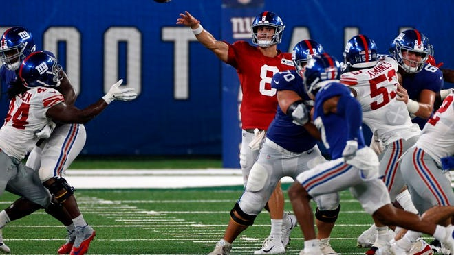 New York Giants quarterback Daniel Jones (8) passes during a scrimmage at the NFL football team's training camp in East Rutherford, N.J., Friday, Aug. 28, 2020.