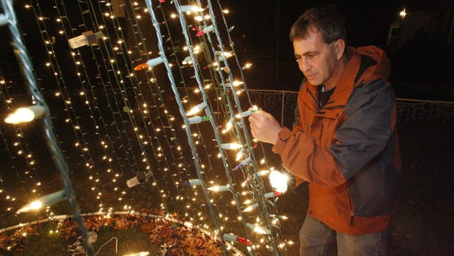 Frank Picozzi looks over a display at his Warwick home in 2010. He decorates every year with thousands of lights synced to music.