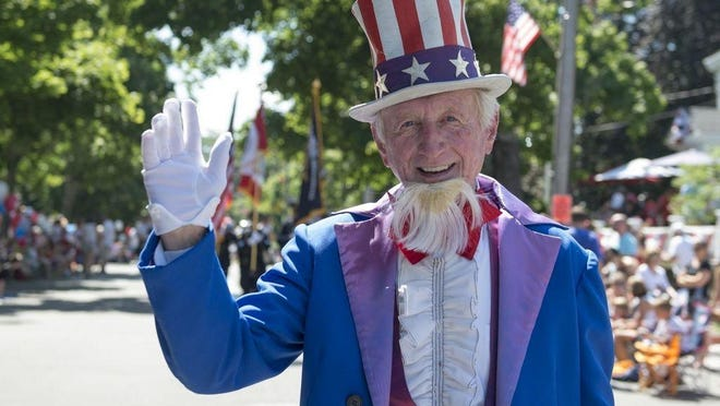 Uncle Sam greets spectators has he makes his way along the Hingham, Mass. Fourth of July Parade route.