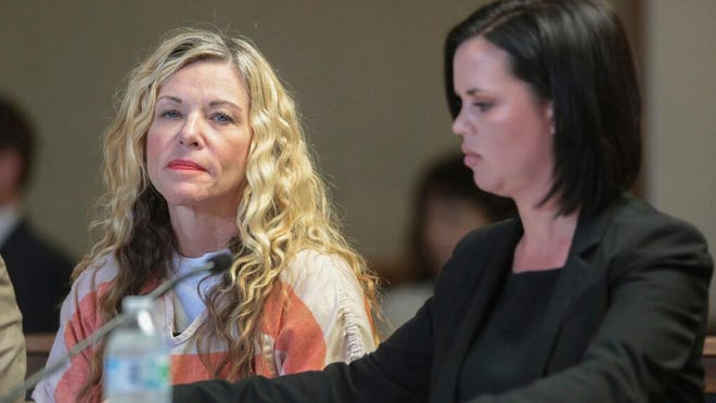 In this March 6, 2020, file photo, Lori Vallow Daybell glances at the camera during her hearing, with her defense attorney, Edwina Elcox, right, in Rexburg, Idaho. The bodies of two children uncovered in rural Idaho are a boy and his big sister who have been missing since September, relatives said Wednesday, June 10, bringing a grim end to a search that captivated people worldwide.