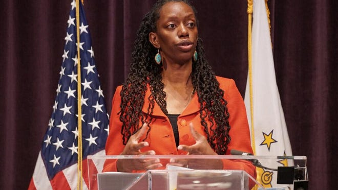 Dr. Nicole Alexander-Scott, director of the Rhode Island Department of Health, discusses the state's response to the coronavirus diuring an address Wednesday. On Friday, the state updated its website to indicate that one more Rhode Islander had died and 59 people tested positive.