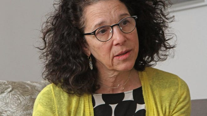 RISD President Rosanne Somerson says the school is talking with union representatives in an effort to avoid layoffs.