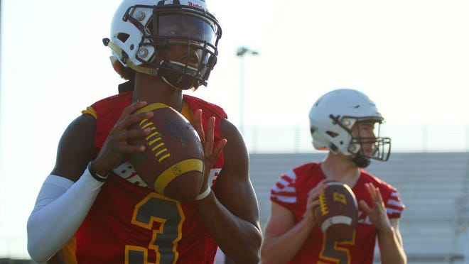 Battle quarterback Khaleel Dampier (3) drops back to pass in a drill during preseason practice last year.
