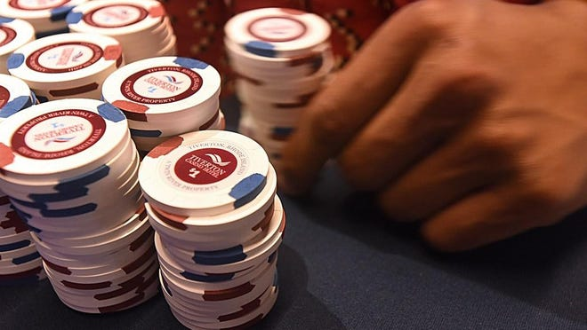 Stacks of chips sit on a table at Tiverton Hotel Casino.