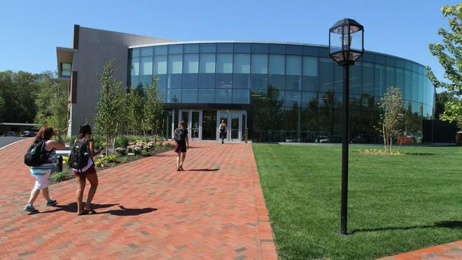 Bryant University, its Academic Innovation Center shown in this photograph, has confirmed that one person tested positive for COVID and others were quarantined after a series of unauthorized parties Friday night.