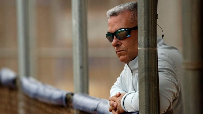 In this Feb. 13, 2019, file photo, Kansas City Royals general manager Dayton Moore watches a workout during spring training baseball practice in Surprise, Ariz.
