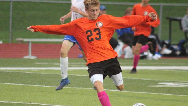 Kirksville forward Bryce Ensign takes a shot against Moberly.