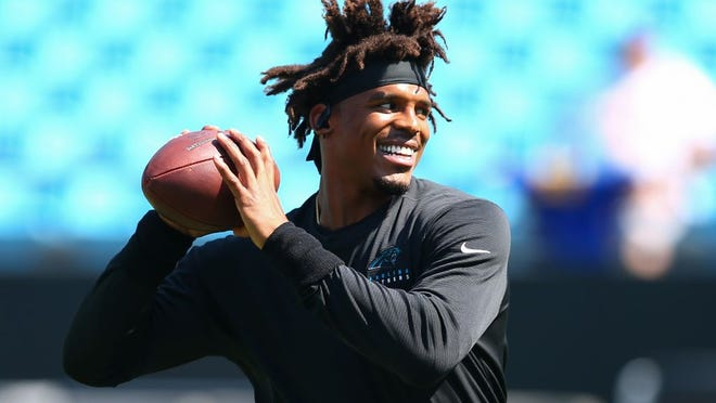 Quarterback Cam Newton warms up prior to a game with  Carolina Panthers in 2019.