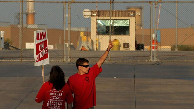 Production workers with United Auto Workers Local 2250 picket in 2019 outside the General Motors truck assembly plant in Wentzville. GM is laying off some workers at the plant because of concerns about the coronavirus.
