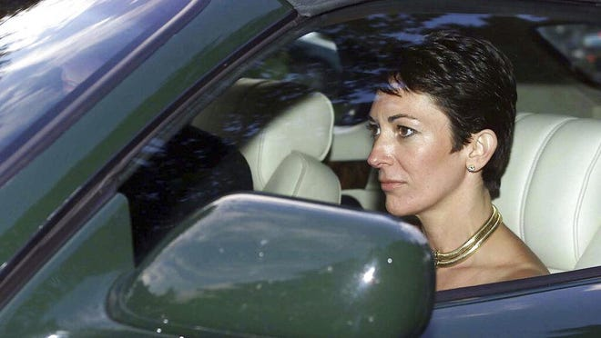 In this Sept. 2, 2000 photo, British socialite Ghislaine Maxwell, driven by Britain's Prince Andrew leaves the wedding of a former girlfriend of the prince, Aurelia Cecil, at the Parish Church of St Michael in Compton Chamberlayne near Salisbury, England. The FBI said Thursday July 2, 2020, Ghislaine Maxwell, who was accused by many women of helping procure underage sex partners for Jeffrey Epstein, has been arrested in New Hampshire.
