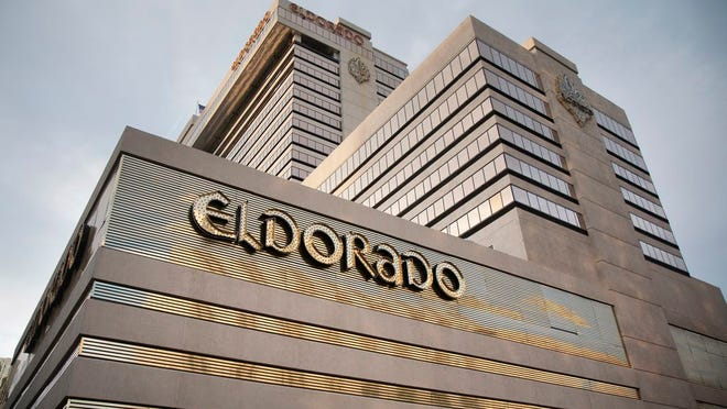 FILE - In this June 24, 2019, file photo, the Eldorado Resort Casino stands in Reno, Nev. A Nevada company that started in 1973 in Reno has completed a $17.3 billion buyout of Caesars Entertainment Corp. and will take the iconic company's name going forward as the largest casino owner in the world. Eldorado Resorts said Monday, July 20, 2020, it now owns more than 55 casino properties in 16 U.S. states.
