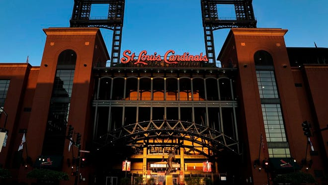 Busch Stadium, home of the St. Louis Cardinals, remains quiet Friday, Aug. 7, 2020, in St. Louis.