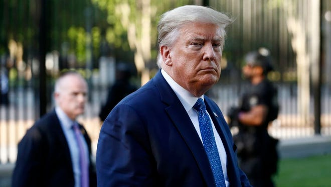 In this Monday, June 1, 2020, file photo, President Donald Trump returns to the White House in Washington. Trump is traveling to Maine on Friday, June 5, 2020, to visit a company that makes specialized swabs for coronavirus testing.