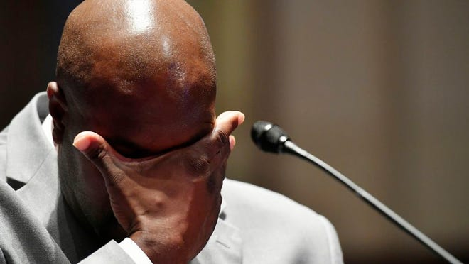 Philonise Floyd, a brother of George Floyd, wipes his face as he testifies during a House Judiciary Committee hearing on proposed changes to police practices and accountability on Capitol Hill, Wednesday, June 10, 2020, in Washington.