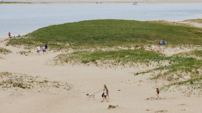 Families arrive at Chatham Lighthouse Beach to enjoy the beautiful weather on Tuesday afternoon.