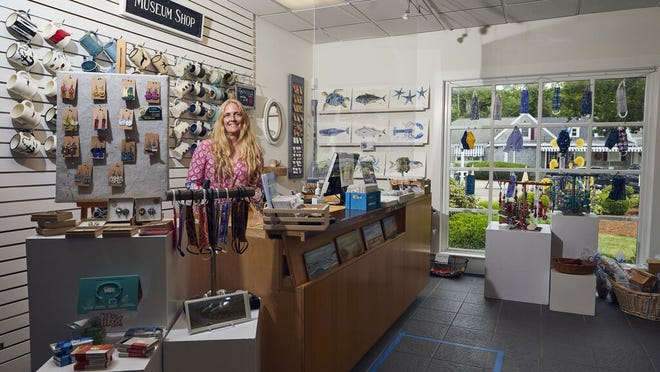 Tania Tilton, of Yarmouth Port, welcomes the public to the museum shop at the Cape Cod Museum of Art in Dennis. Area museums and cultural centers started reopening their physical doors last week for the first time since mid-March as part of the state's Phase 3 plan.