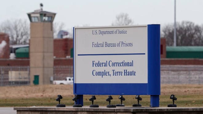The guard tower flanks the sign at the entrance to the U.S. Penitentiary in Terre Haute, Indiana, in this December 2019 photo. Daniel Lewis Lee, 47, of Yukon, Oklahoma, died by lethal injection at the federal prison Tuesday, the first federal execution in nearly two decades.