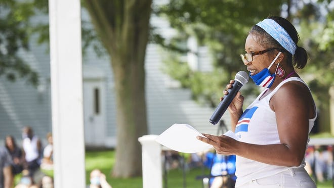 "Corrie Green, of Mashpee, speaks at a ""POC Speak Up"" storytelling and listening event Saturday afternoon on the Hyannis Village Green. Speakers  shared their experiences with racism, police discrimination and marginalization on Cape Cod."