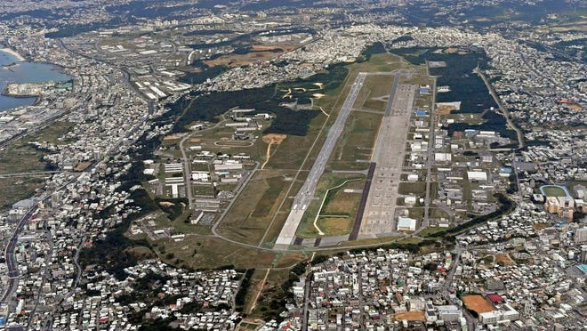 This Jan. 27, 2018, aerial file photo shows U.S. Marine Air Station Futenma in Ginowan, Okinawa, southern Japan. Okinawan officials said Saturday, July 11, 2020 that dozens of U.S. Marines have been confirmed to have infected with the coronavirus at two bases, Futenma and Camp Hansen, on the southern Japanese island in what is feared to be a massive outbreak, and demanded adequate explanation from the U.S. military officials.