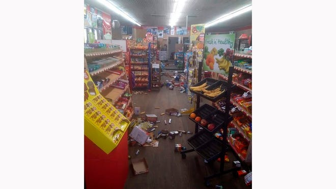 Various items litter the floor of the 4 Brothers Store in Sparta, N.C. after an earthquake shook much of North Carolina early Sunday, Aug. 9, 2020.