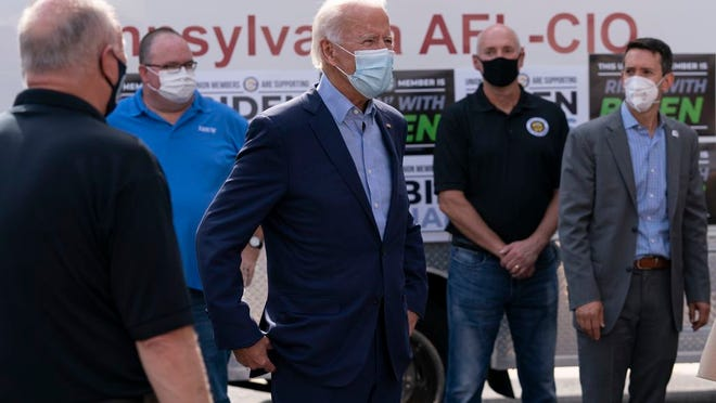 Democratic presidential candidate former Vice President Joe Biden talks with union leaders after taking photographs outside the AFL-CIO headquarters in Harrisburg, Pa., Monday, Sept. 7, 2020.