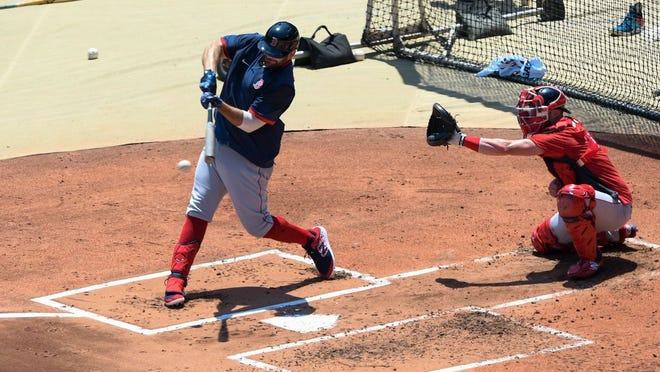 Boston's Mitch Moreland bats during practice at Fenway Park on Sunday.