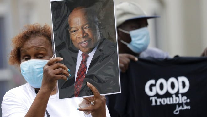 Mourners stand outside Ebenezer Baptist Church in Atlanta during Thursday's funeral for Rep. John Lewis. Lewis, who carried the struggle against racial discrimination from the Southern battlegrounds of the 1960s to the halls of Congress, died July 17.